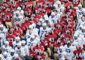 Members of the Harvard Crimson and of the Yale Bulldogs shake hands after the game on November 20 2010 at Harvard Stadium in Cambridge Massachusetts...