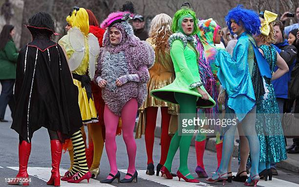 Members of the Hasty Pudding theater troupe gather before the start of the parade through Harvard Square Actress Claire Danes not pictured was named...
