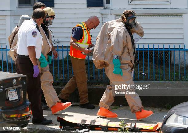 Members of the Hazmat unit respond to the scene of an overdose that killed two people in Lawrence MA on Jul 17 2017 The victims were discovered at...
