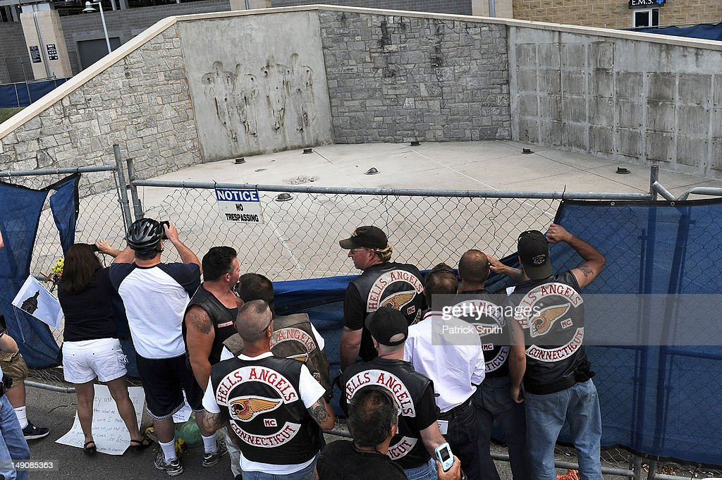 Members of the Hells Angels from Connecticut visit the site where the statue of former Penn State University football coach Joe Paterno once stood outside Beaver Stadium on July 22, 2012 in State College, The statue was removed by workers after Pennsylvania. Penn State's president Rodney Erickson made the decision Sunday in the wake of the child sex scandal of former assistant football coach Jerry Sandusky. According to an FBI report, it is believed that Paterno had detailed knowledge of Jerry Sandusky sexually abusing children before and after Sandusky retired from coaching at Penn State.