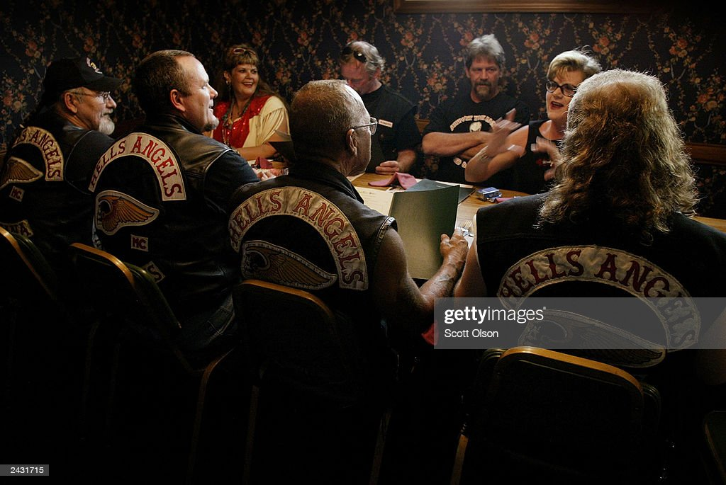 Members of the Hells Angels motorcycle club, with wives and friends, order dinner at a restaurant August 23, 2003 in Quincy, Illinois. The motorcycle club was in Quincy for a book signing event and party honoring Sonny Barger (2nd-R/back to camera), founder of the Oakland, California charter of the Hells Angels.