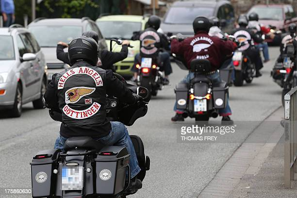 Members of the Hells Angels motorcycle gang wear gear with the club's logo and read 'Goettingen' as they arrive for a funeral in RansbachBaumbach...