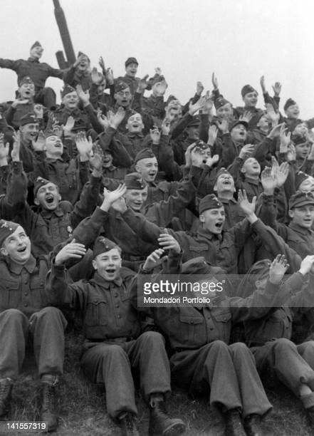 Members of the Hitler Youth rejoicing at becoming part of the Luftwaffe auxiliary services Germany 1943
