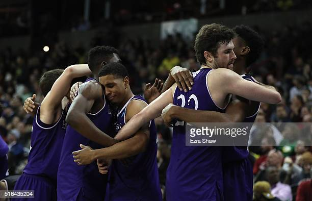 Members of the Holy Cross Crusaders hug after their 5291 loss to the Oregon Ducks in the second half during the first round of the 2016 NCAA Men's...