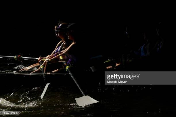 Members of the Holy Cross Women's Club Eights team in action during the Head of the Charles Regatta on October 21 2017 in Boston Massachusetts