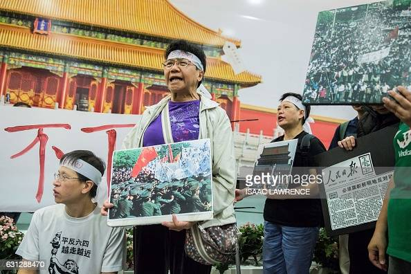 Members of the Hong Kong Alliance in Support of Patriotic Democratic Movements in China hold placards during a protest against the 1989 Tiananmen...