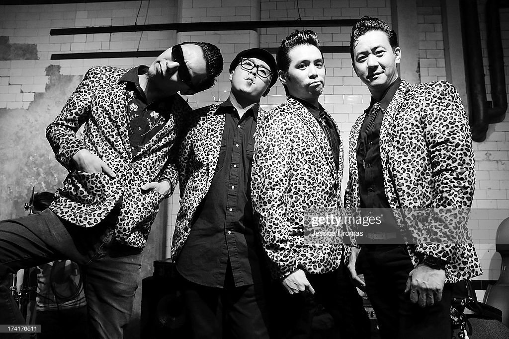 Members of the Hong Kong Rockabilly band ' The Boogie Playboys' left to right Chan Sze-chai, K13, Barry and Felix pose for a photo at the Dirty Boogie Rockabilly Festival at the Fringe Club on July 20, 2013 in Hong Kong, Hong Kong. (Photo by Jessica Hromas/Getty Images) (