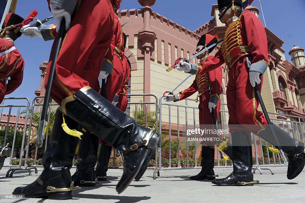 Members of the Honor Guard parade in front of the Mountain Barracks (Cuartel de la Montana) where the remains of late Venezuelan President Hugo Chavez are staying in, in the 23 de Enero low income neighborhood in Caracas, on March 28, 2013.