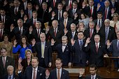 Members of the House are sworn in during a ceremony in the House of Representatives as the 114th Congress convenes on Capitol Hill January 6 2015 in...