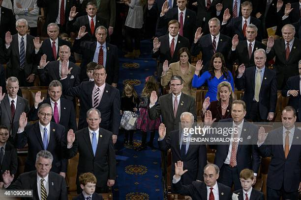Members of the House are sworn in during a ceremony on the floor of the House of Representatives as the 114th Congress convenes on Capitol Hill...