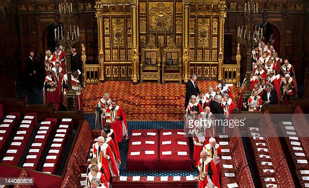 Members of the House of Lords enter the Chamber to hear Britain's Queen Elizabeth II deliver the Queen's Speech during the State Opening of...