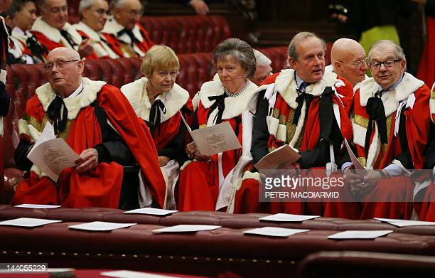Members of the House of Lords sit in the chamber as they wait for the State Opening of Parliament ceremonials in the Palace of Westminster in London...