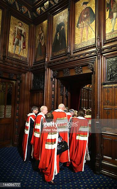 Members of The House of Lords walk into the Chamber for the State Opening of Parliament on May 9 2012 in London England Queen Elizabeth II unveiled...