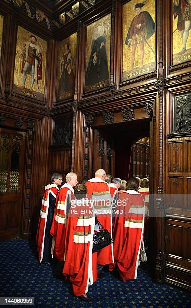 Members of The House of Lords walk into the Chamber for the State Opening of Parliament at the Palace of Westminster in London on May 9 2012...