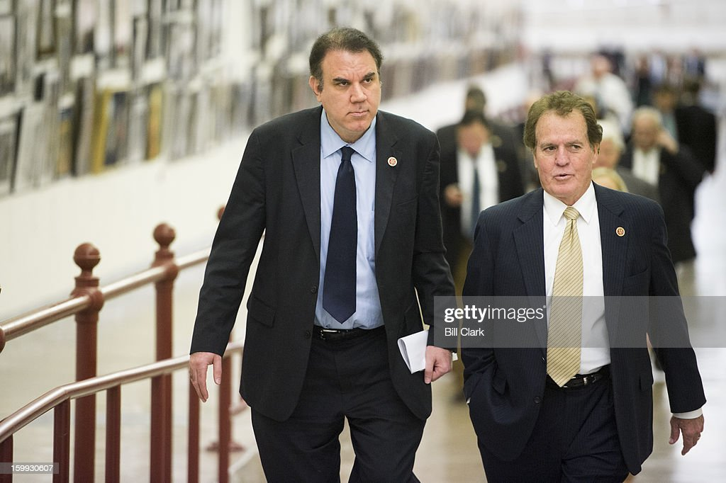 Members of the House of Representatives, including Rep. Alan Grayson, D-Fla., and Rep. Phil Gingrey, R-Ga.,, walk through the Cannon Tunnel to the Capitol for votes on Wednesday, January 23, 2013.