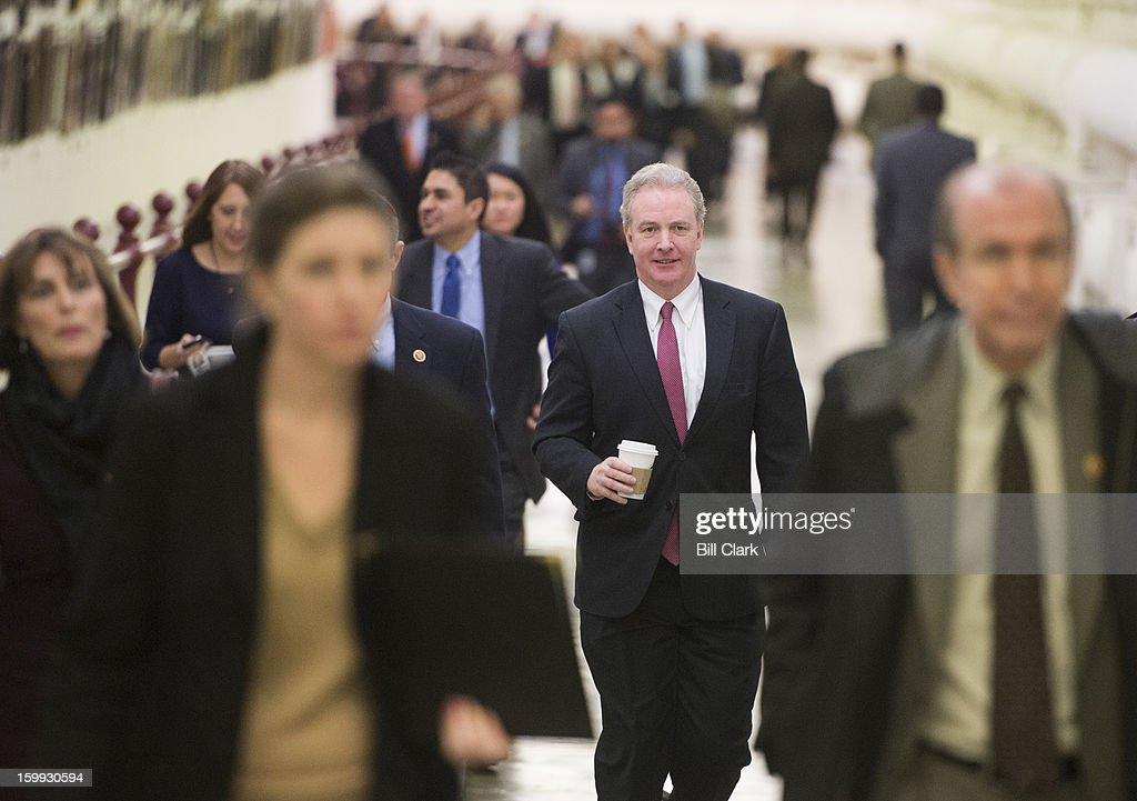Members of the House of Representatives, including Rep. Chris Van Hollen, D-Md., walk through the Cannon Tunnel to the Capitol for votes on Wednesday, January 23, 2013.