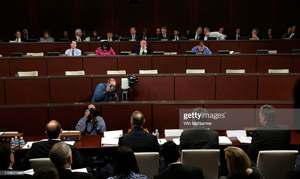Members of the House Select Intelligence Committee listen to testimony from (R-L) Deputy Attorney General James Cole; Chris Inglis, Deputy Director of the NSA; General Keith Alexander, director of the National Security Agency; and Sean Joyce, deputy director of the Federal Bureau of Investigation June 18, 2013 in Washington, DC. The committee heard testimony on the topic of 'how the disclosed NSA programs protect Americans from terror attacks on US soil, and why the disclosure of that classified information aids our adversaries.'