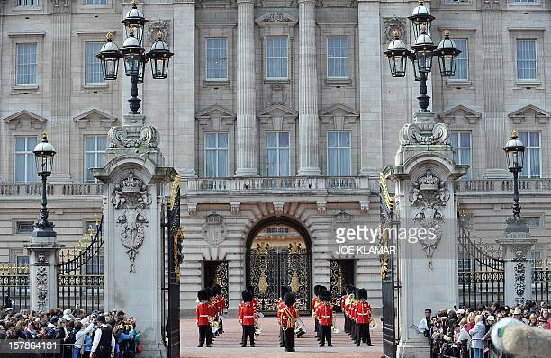 Members of the household brigade stand guard in front of Buckingham palace in London on April 28 2011 Britain's Prince William is to marry his...