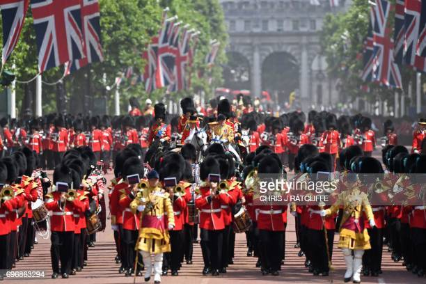 Members of the Household Cavalry escort the Royal Carriage back to Buckingham Palace after attending 'Trooping the Colour' on Horse Guards Parade to...