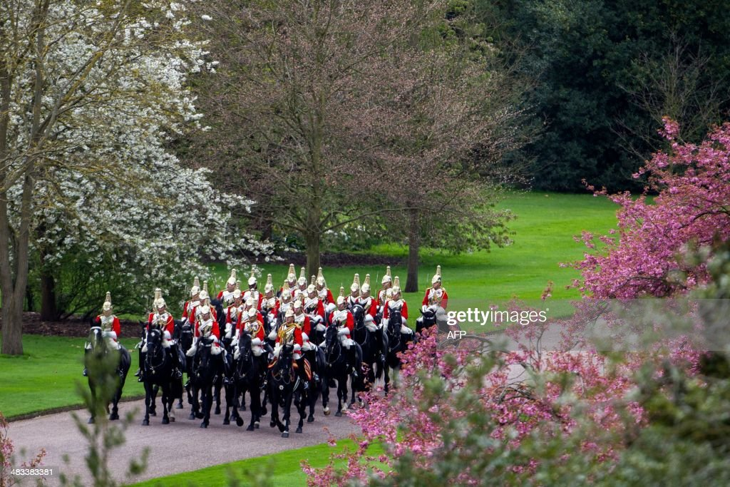 Members of the Household cavalry in the grounds of Windsor Castle, in Windsor, west of London on April 8, 2014. Ireland's Michael D. Higgins is making the first state visit by a president of the republic since it gained independence from neighbouring Britain. The visit comes three years after Queen Elizabeth II made a groundbreaking trip to the republic, which helped to heal deep-rooted unease and put British-Irish relations on a new footing. Higgins' return visit will be seen as an official sign of further progress following the hard-won peace in Northern Ireland, which remains part of the United Kingdom.