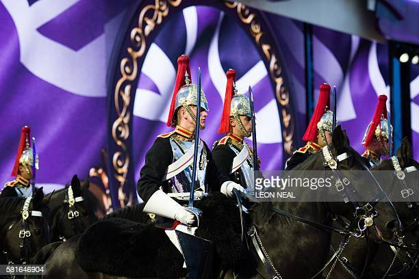 Members of the Household Cavalry perform in the arena during the final night of The Queen's 90th Birthday Celebrations at the Royal Windsor Horseshow...