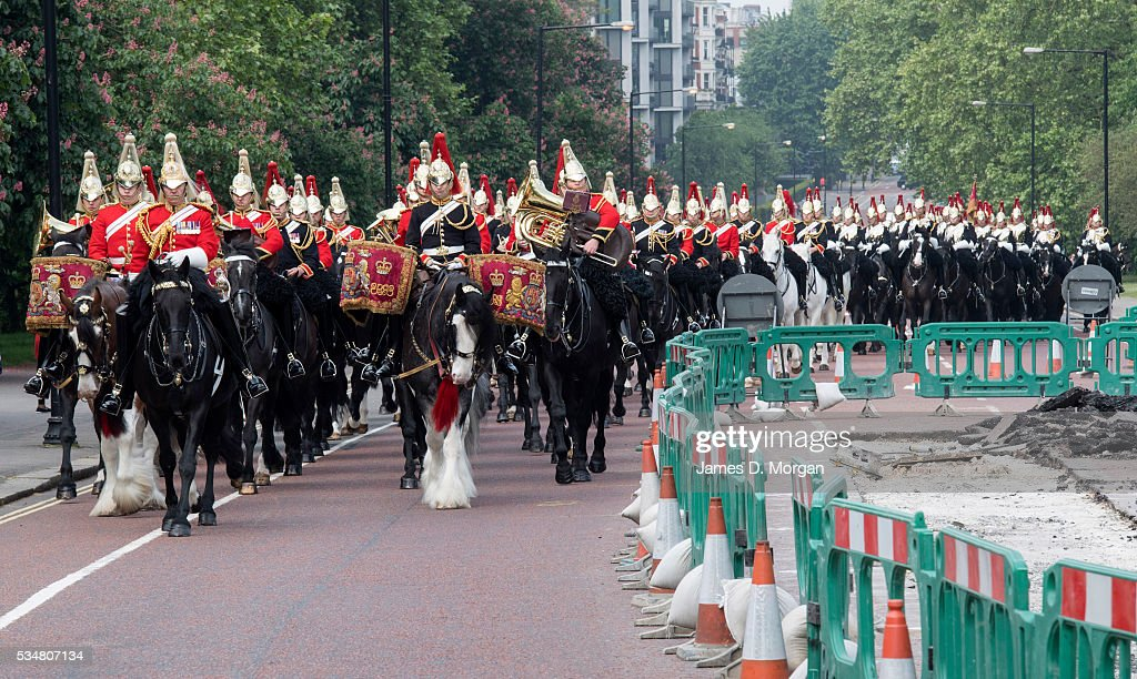 Members of the Household Cavalry, the British Army's official bodyguard of Queen Elizabeth II navigate around roadworks as they travel to Horse Guard's Parade for the General's Review on May 28, 2016 in London, England.