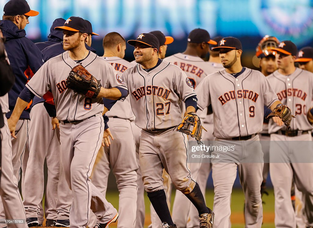 Members of the Houston Astros celebrate after defeating the Seattle Mariners 6-1 at Safeco Field on June 12, 2013 in Seattle, Washington.