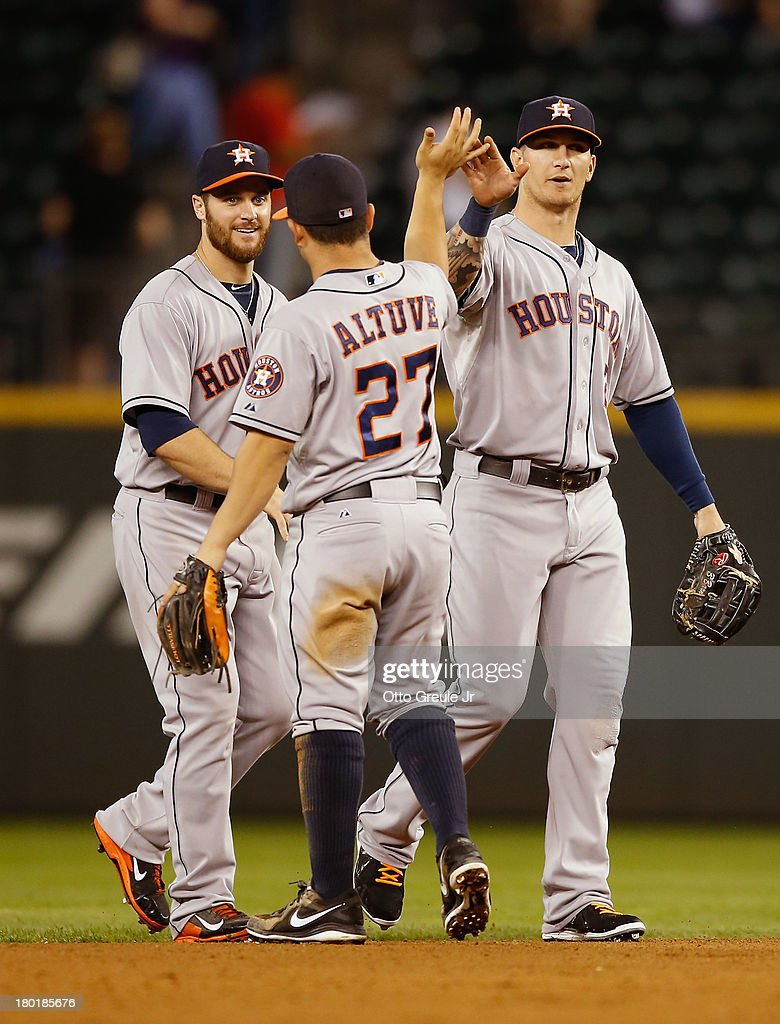 Members of the Houston Astros celebrate after defeating the Seattle Mariners 6-4 at Safeco Field on September 9, 2013 in Seattle, Washington.