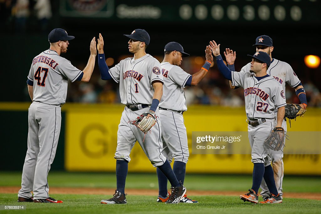 Members of the Houston Astros celebrate after defeating the Seattle Mariners 7-3 at Safeco Field on July 15, 2016 in Seattle, Washington.