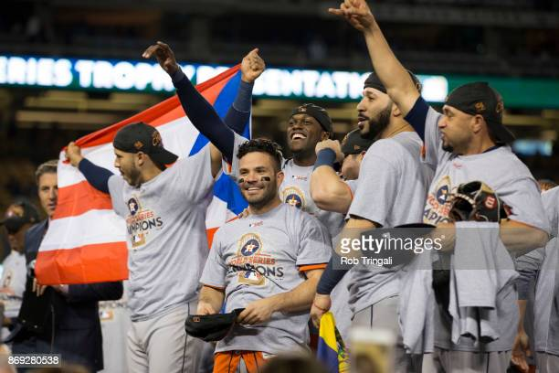 Members of the Houston Astros pose for a photo with the Commissioner's Trophy after the Astros defeated the Los Angeles Dodgers in Game 7 of the 2017...
