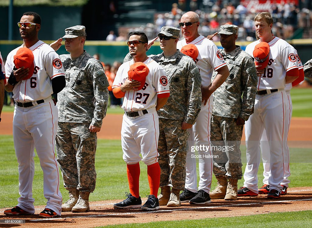 Members of the Houston Astros pose with serviceman during Military Appreciation Day before their game against Chicago White Sox at Minute Maid Park on May 17, 2014 in Houston, Texas.