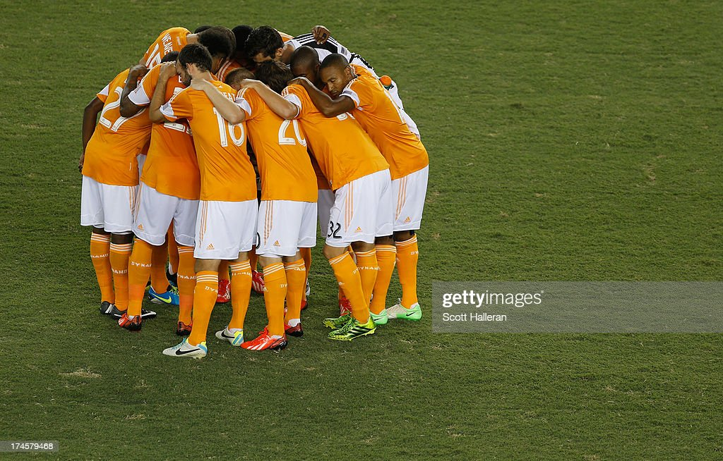 Members of the Houston Dynamo huddle on the field before the game against the Chicago Fire at BBVA Compass Stadium on July 27, 2013 in Houston, Texas.