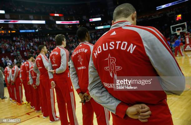 Members of the Houston Rockets stand during the National Anthem before the game against the Los Angeles Clippers at the Toyota Center on March 29...