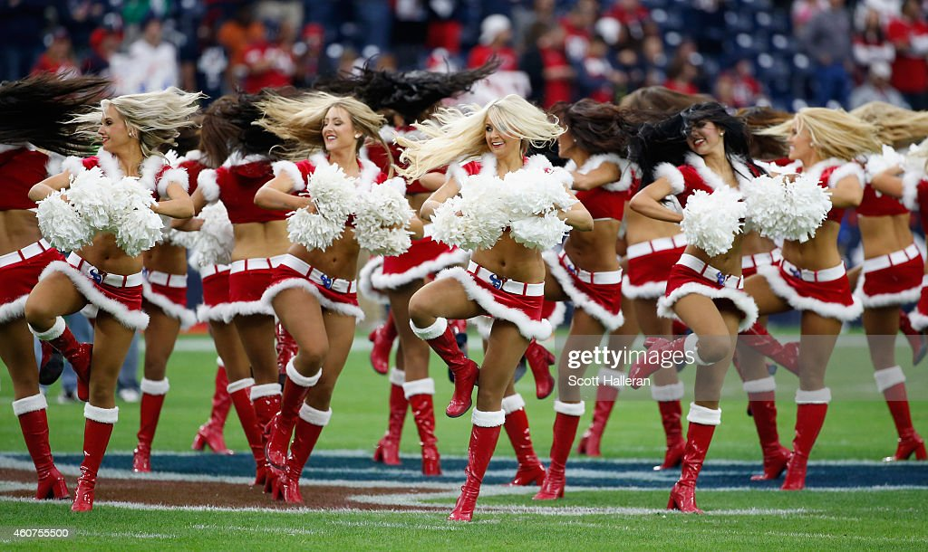 Members of the Houston Texans cheerleaders perform during their game against the Baltimore Ravens at NRG Stadium on December 21, 2014 in Houston, Texas.