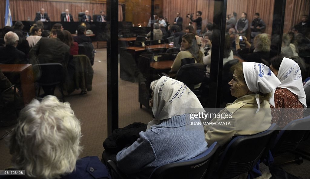 Members of the human rights organization Madres de Plaza de Mayo wait to hear the sentence to be handed down by the court in the trial on Operation Condor, in which six South American dictatorships collaborated to torture and kill their opponents, in Buenos Aires on May 27, 2016. South American ex-military leaders faced judgment Friday for their alleged role in the torture and assassination of leftist dissidents during a US-backed crackdown by the region's dictatorships during the 1970s and 1980s. Argentine judges were considering their verdict in the trial of 18 former army officers accused of taking part in 'Operation Condor.' In that scheme, the military regimes of Argentina, Bolivia, Brazil, Chile, Paraguay and Uruguay helped each other track down and kill leftist dissidents. On Friday, the court convened to deliver its verdict after a three-year trial -- the first to try the crimes committed under the Condor plan / AFP / JUAN