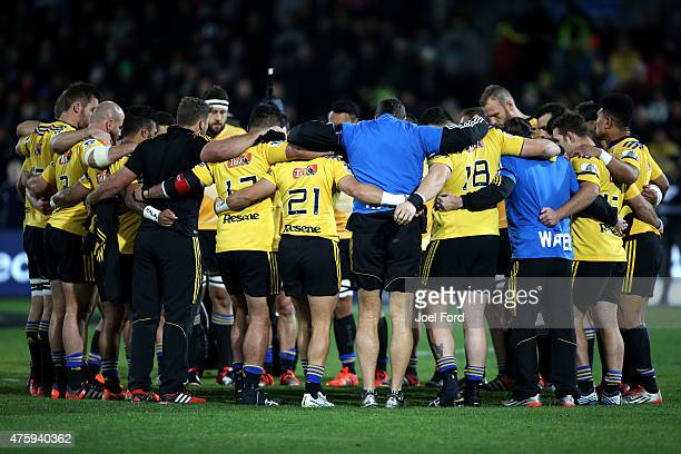 Members of the Hurricanes observe a minutes silence for Jerry Collins during the round 17 Super Rugby match between the Hurricanes and the...