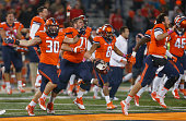 Members of the Illinois Fighting Illini celebrate after defeating the Nebraska Cornhuskers at Memorial Stadium on October 3 2015 in Champaign...