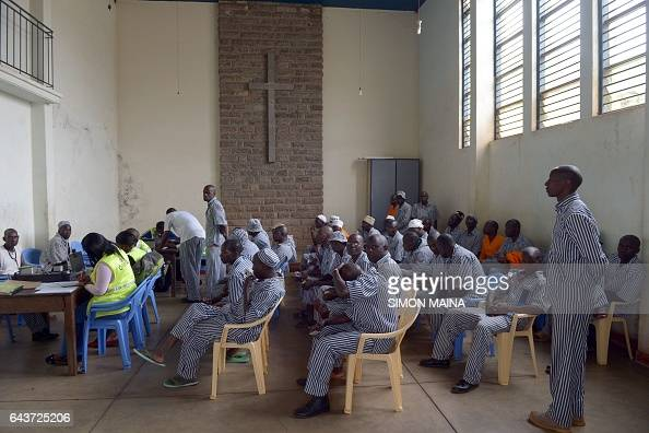 Members of the Independent Electoral and Boundaries Commission register Kenyan prisoners to vote for this year Kenyan general election as the rest of...
