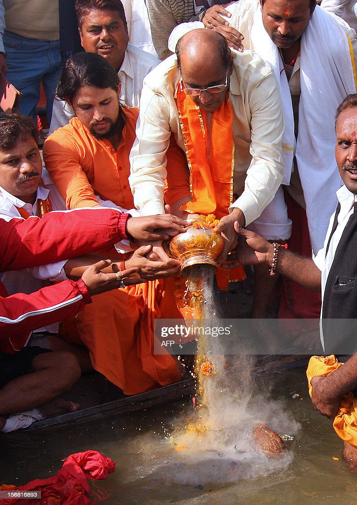 Members of the Indian Hindu nationalist Shiv Sena party pour the cremated ashes of late party founder Bal Thackeray at Sangam in Allahabad on November 22, 2012. Fiery Indian nationalist Bal Thackeray, who founded the right-wing Hindu party Shiv Sena, died on November 15 after suffering cardiac arrest.