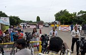 Members of the Indian media gather outside Tambaram Airforce station in Chennai on July 23 2016 India on July 22 mounted a massive search and rescue...