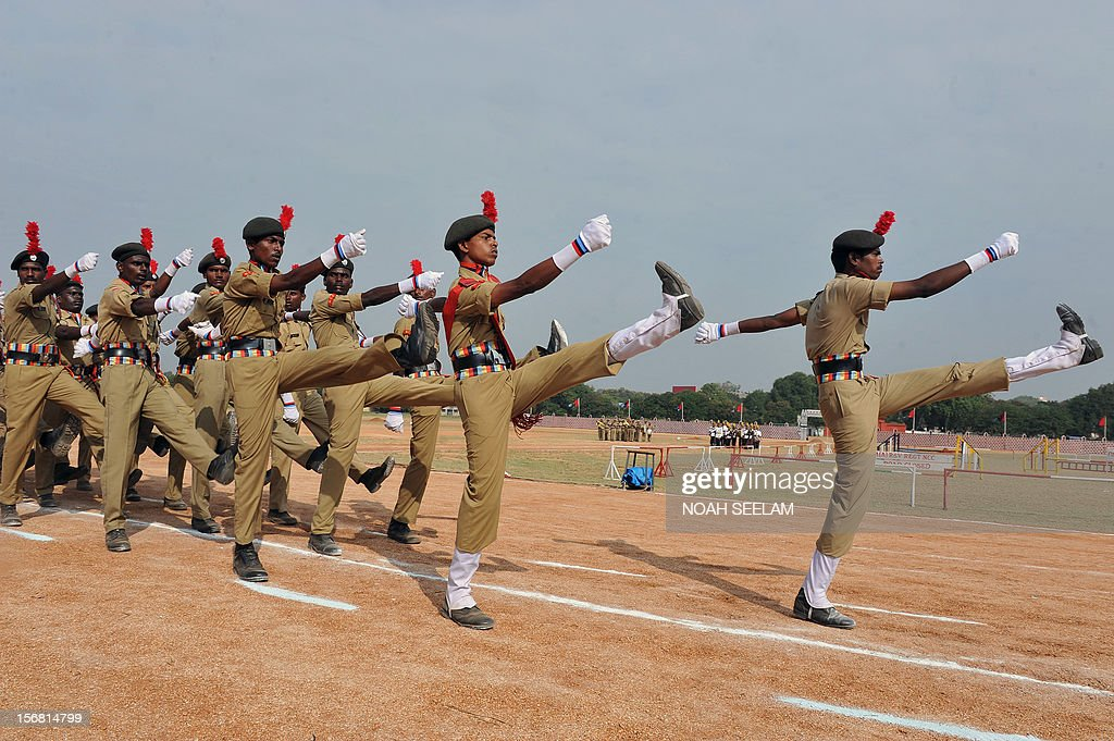 Members of the Indian National Cadet Corps (NCC) participate in a march past during the 64th NCC day celebrations in Secunderabad, the twin city of Hyderabad, on November 22, 2012. The NCC,a voluntary organisation which recruits cadets from secondary schools and colleges, was formed in 1948 to develop social service and leadership skills among participating Indian youth under the auspices of the Ministry of Defence. AFP PHOTO / Noah SEELAM