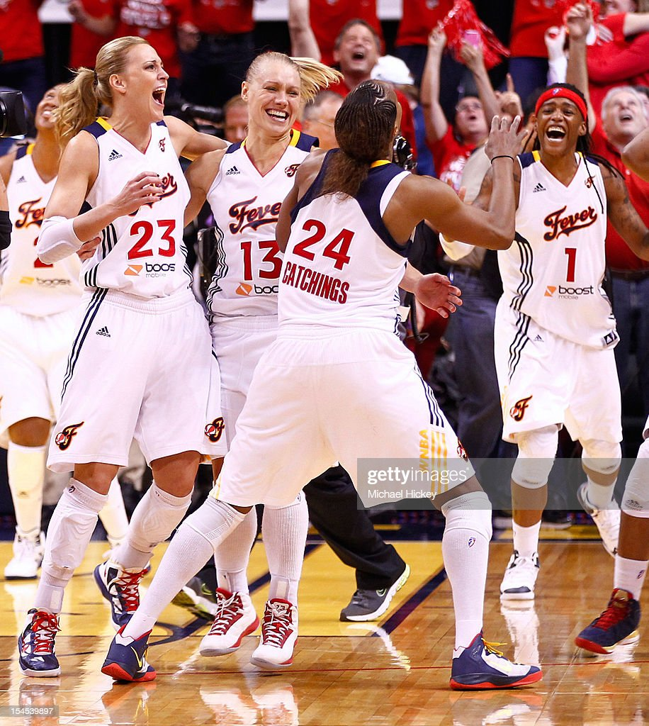Members of the Indiana Fever celebrate after defeating Minnesota Lynx in Game Four of the 2012 WNBA Finals on October 21, 2012 at Bankers Life Fieldhouse in Indianapolis, Indiana.