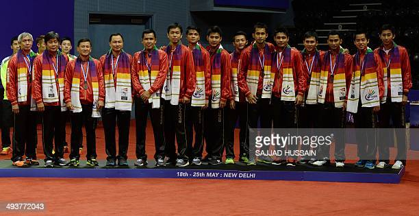 Members of the Indonesian men's badminton team pose on the podium with bronze following the Thomas Cup badminton tournament at Siri Fort Stadium in...