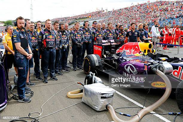 Members of the Infiniti Red Bull Racing team observe a minute's silence in tribute to Jules Bianchi on the grid before the Formula One Grand Prix of...