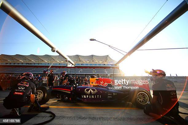 Members of the Infiniti Red Bull Racing team take part in a pit stop practice session during previews ahead of the United States Formula One Grand...