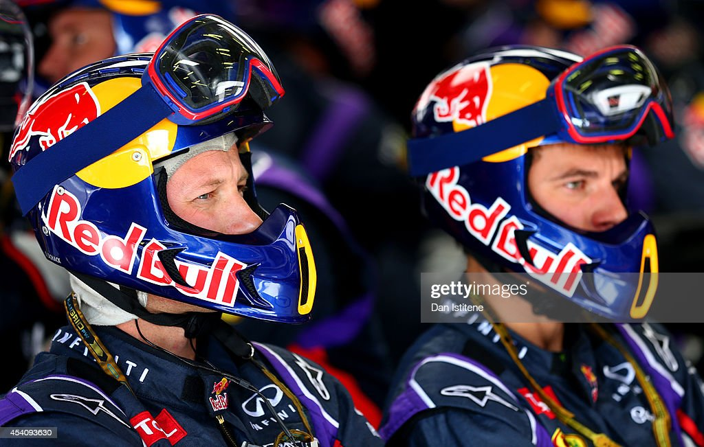 Members of the Infiniti Red Bull Racing team watch the action in the garage during the Belgian Grand Prix at Circuit de Spa-Francorchamps on August 24, 2014 in Spa, Belgium.