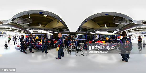 Members of the Infiniti Red Bull Racing team work in the garage ahead of the Brazilian Formula One Grand Prix at Autodromo Jose Carlos Pace on...