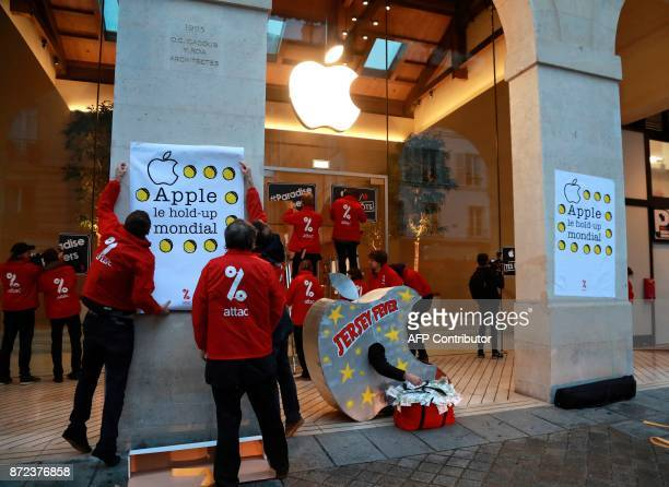 Members of the international Association for the Taxation of financial Transactions and Aid to Citizens one wearing an apple reading 'Jersey fever'...