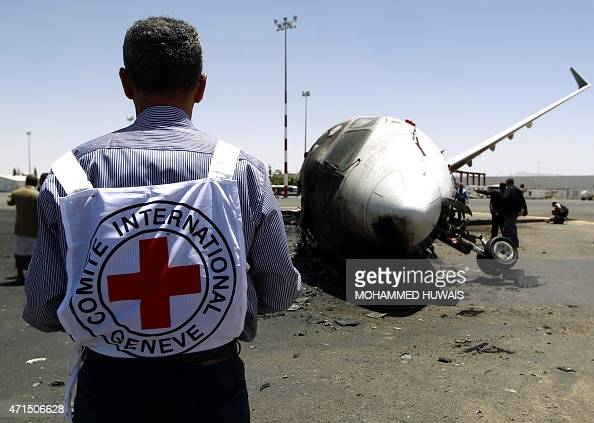 A members of the International Committee of the Red Cross stands in front of a destroyed Felix Airways plane after it was hit in an air strike at the...