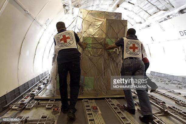 Members of the International Committee of the Red Cross unload from a plane Emergency medical aid at the international airport in Sanaa on April 11...